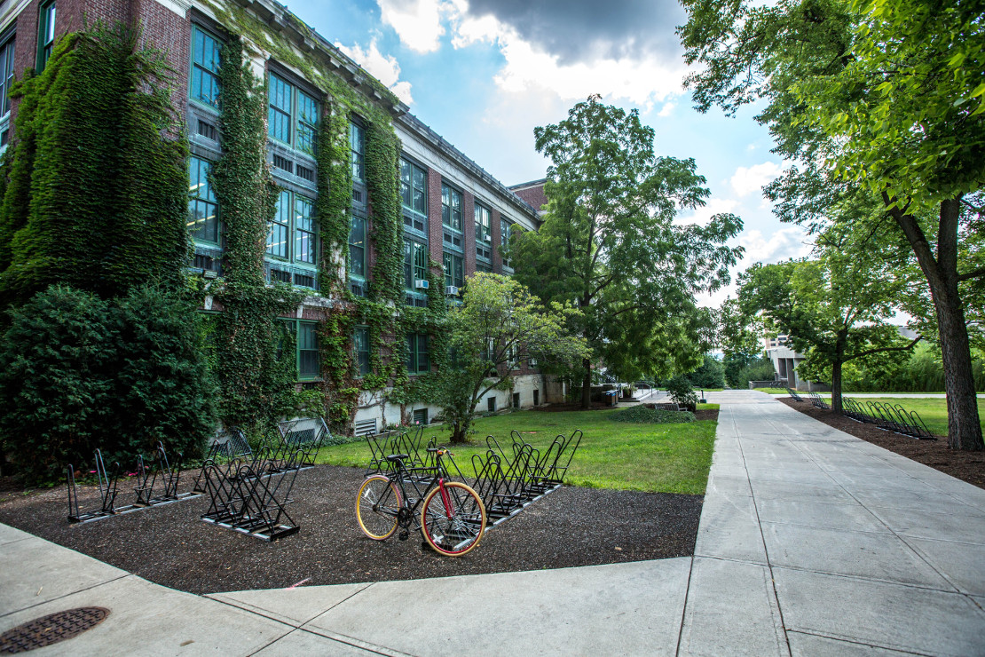 Facilities Management Company Facility Brick Building Green Space Bike Picture