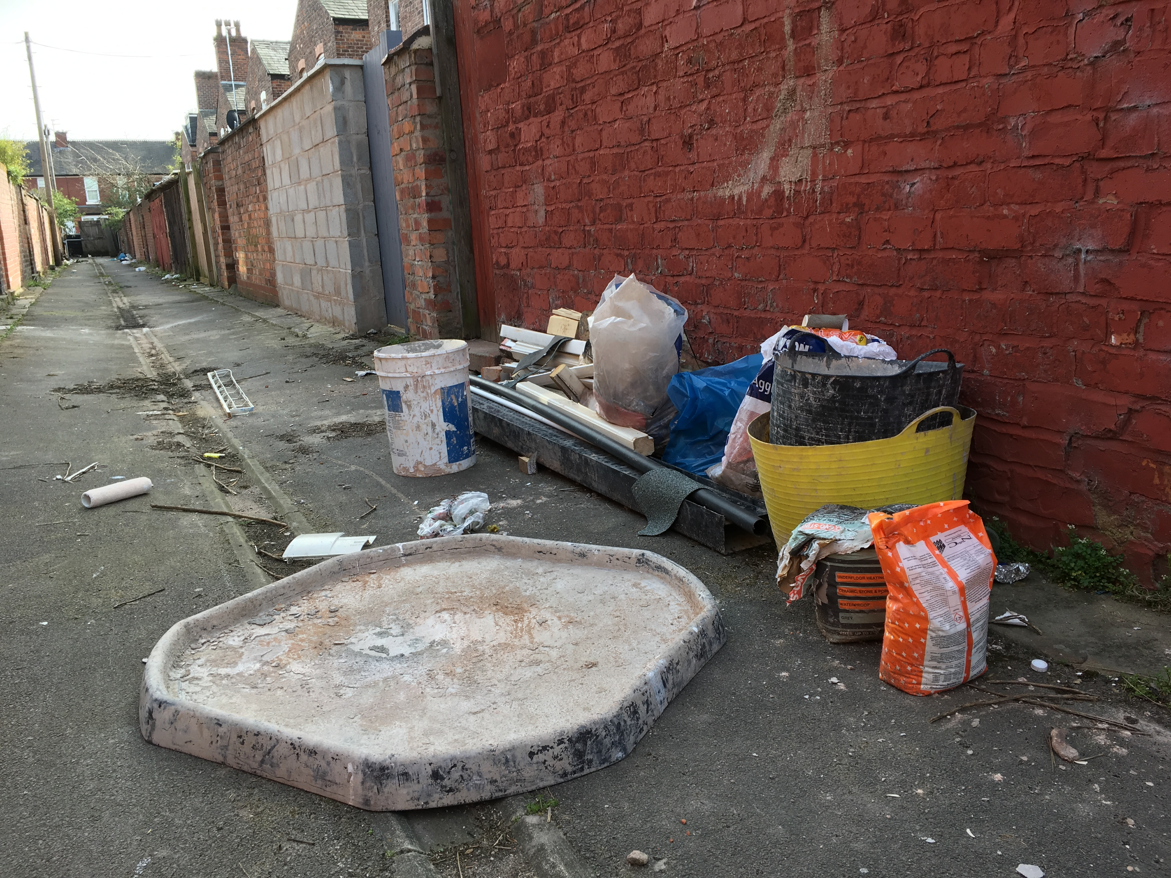 building waste dumped in a Manchester alley photograph